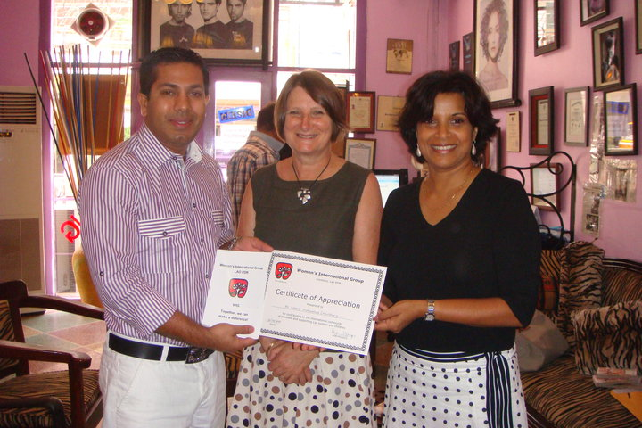 Mr. Sadik Mohammad Chowdhury, MD of L.A.I.D receiving Certificate of Appreciation from Lao Women International Group.
