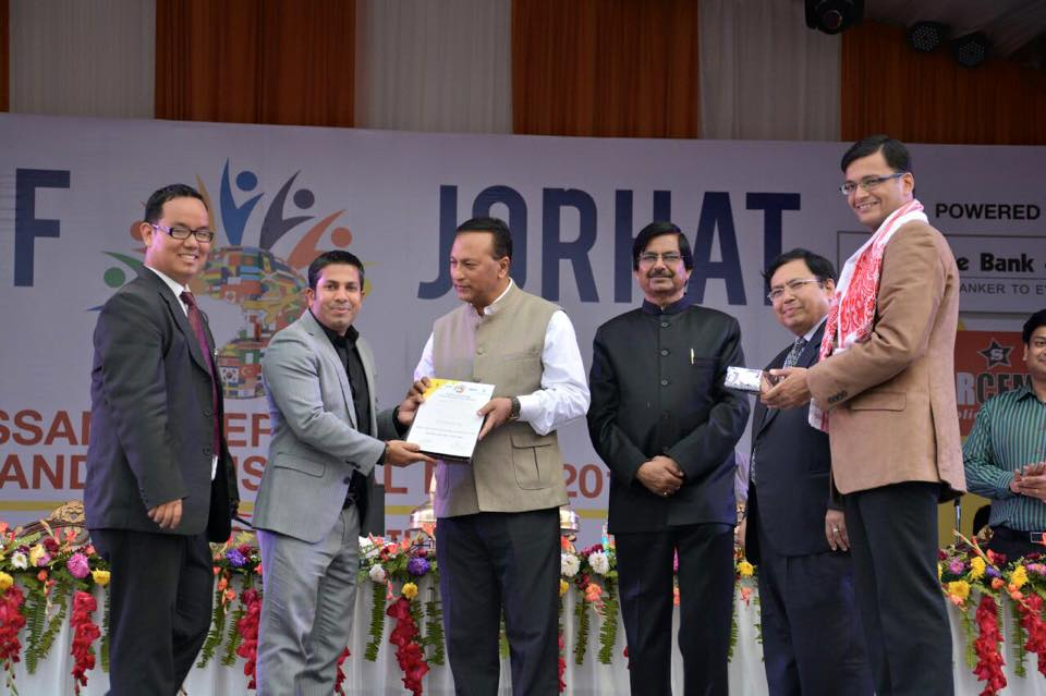 Mr. Sadik Mohammad Chowdhury, MD of L.A.I.D received the Best International Stall Award on behalf of Lao P.D.R from Shri Pradyut Bordoloi Honorable MLA Margherita, Assam, India during the Closing Ceremony of Assam International Trade & Industrial Fair, Jorhat, Assam, India on 25 Feb 2015.