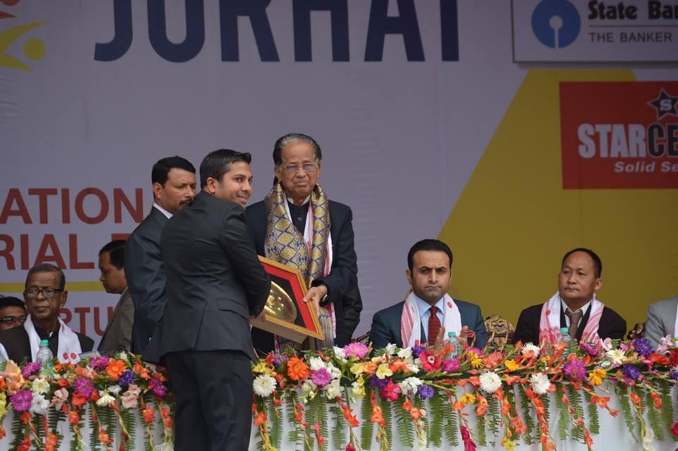 Mr. Sadik Mohammad Chowdhury, MD of L.A.I.D presenting Lao Souvenir to Honorable Chief Minister of Assam Shri Tarun Gogoi at Inauguration Ceremony of Assam International Trade & Industrial Fair, Jorhat, Assam, India on 19 Feb 2015.