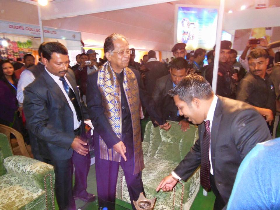 Mr. Sadik Mohammad Chowdhury, MD of L.A.I.D with Honorable Chief Minister of Assam Shri Tarun Gogoi at HSMM Group Kiosk on Inauguration Day of Assam International Trade & Industrial Fair, Jorhat, Assam, India on 19 Feb 2015.